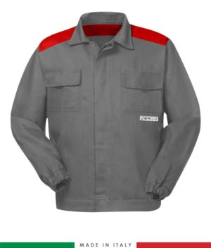 Two-tone trivalent jacket, covered button closure, two chest pockets, elasticated cuffs, color inserts on shoulders and inside neck, color grey/red