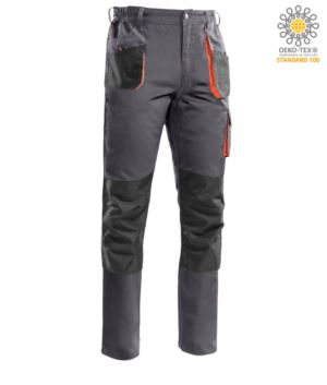 Multi pocket trousers with contrasting orange piping, knee pad holder, reinforced seams. Colour Grey