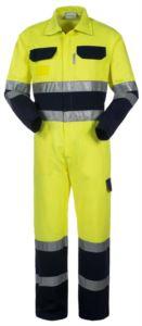 Tuta intera alta visibilità bicolore con chiusura centrale coperta con collo a camicia, doppia banda su fondo gamba, maniche e girovita, multitasche, velcro per portabadge. Certificata EN 20471, colore giallo e blu